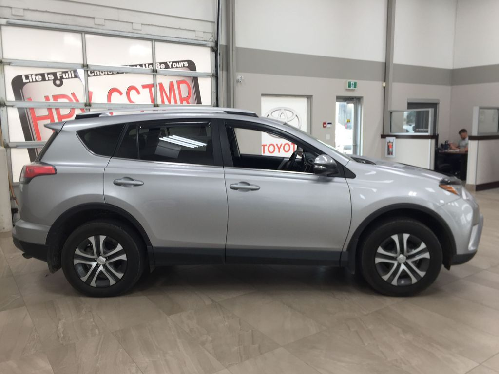 Silver[Silver Sky Metallic] 2016 Toyota RAV4 LE AWD Right Side Photo in Sherwood Park AB