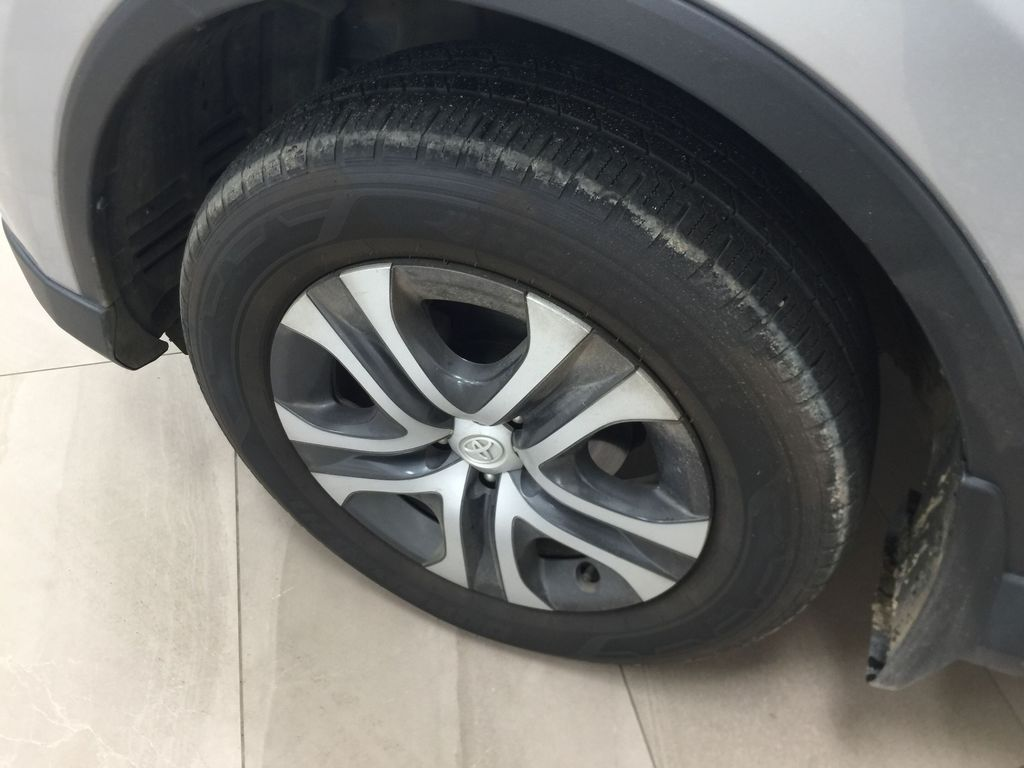 Silver[Silver Sky Metallic] 2016 Toyota RAV4 LE AWD Left Front Rim and Tire Photo in Sherwood Park AB