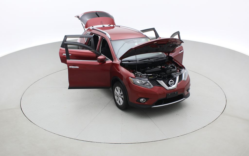 Red[Cayenne Red Metallic] 2016 Nissan Rogue SV AWD - Heated Seats, Backup Camera, Alloy Wheels Left Front Corner Photo in Winnipeg MB
