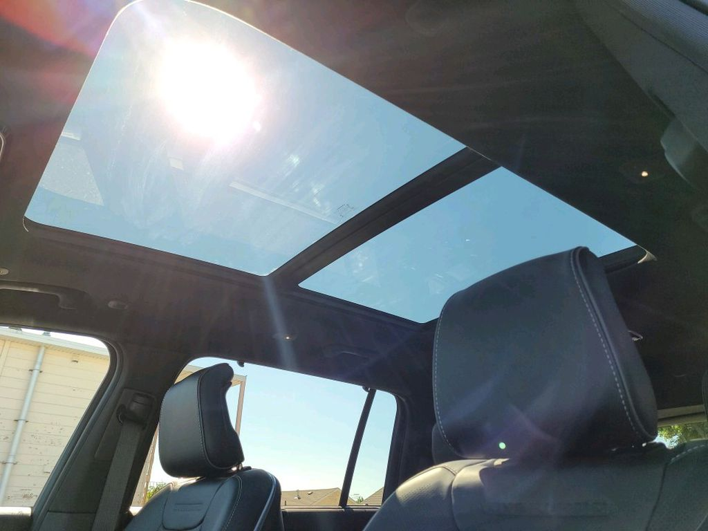 Black 2021 Jeep Grand Cherokee L Steering Wheel and Dash Photo in Fort Macleod AB