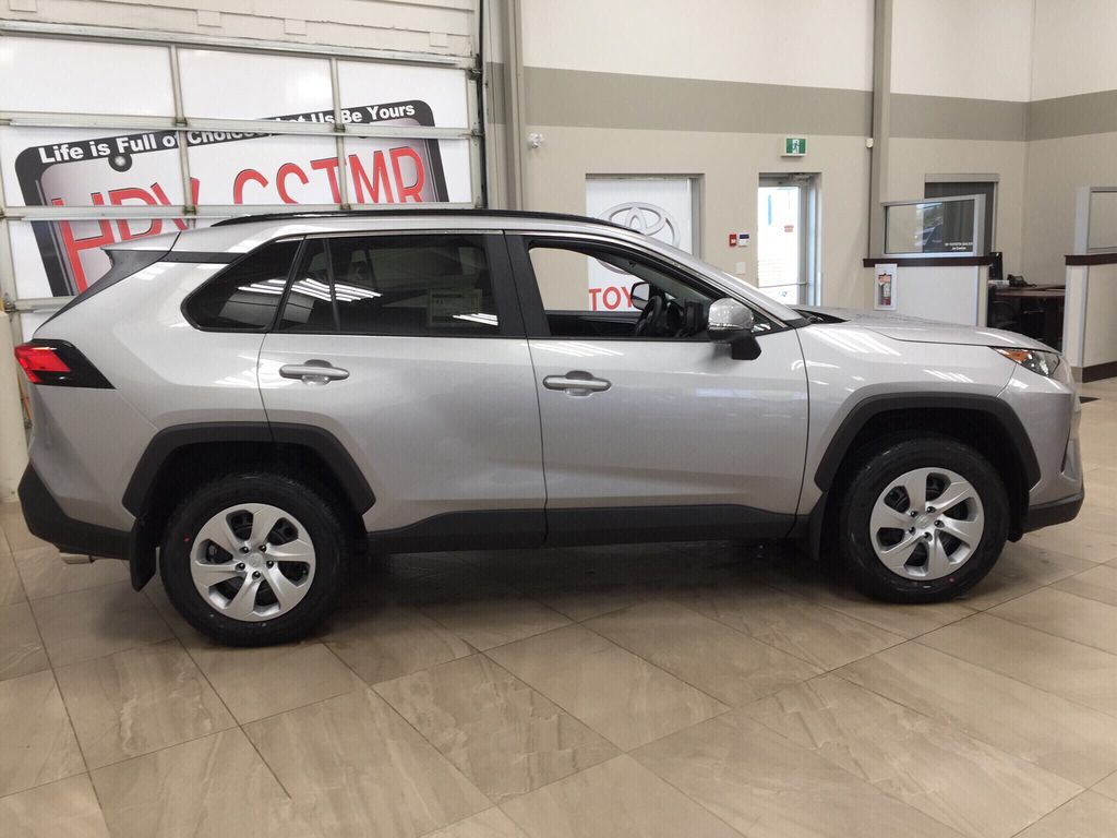 Silver[Silver Sky Metallic] 2021 Toyota RAV4 LE AWD Right Side Photo in Sherwood Park AB