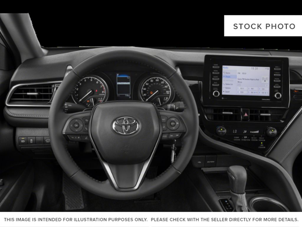 Silver[Celestial Silver Metallic] 2021 Toyota Camry Steering Wheel and Dash Photo in Kelowna BC