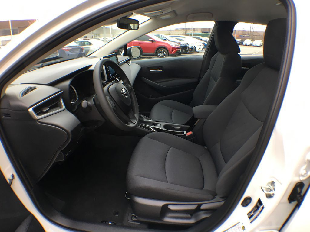 Super White 2021 Toyota Corolla LE Standard Package BPRBLC AM Left Front Interior Door Panel Photo in Brampton ON
