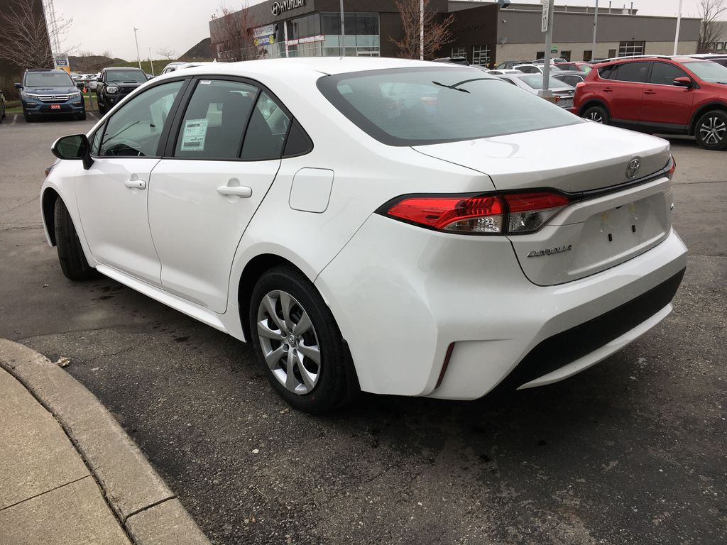 Super White 2021 Toyota Corolla LE Standard Package BPRBLC AM Left Rear Interior Door Panel Photo in Brampton ON