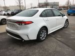 Super White 2021 Toyota Corolla LE Standard Package BPRBLC AM Strng Wheel/Dash Photo: Frm Rear in Brampton ON
