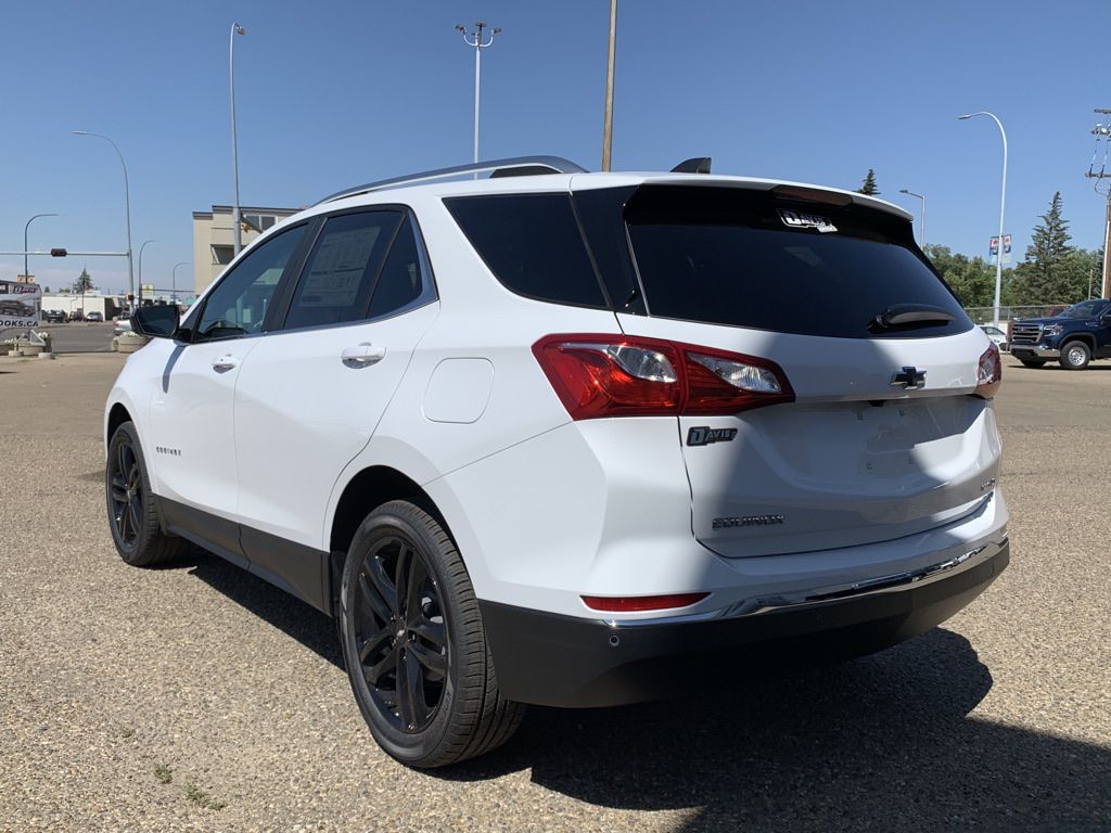 White 2021 Chevrolet Equinox Left Front Rim and Tire Photo in Brooks AB