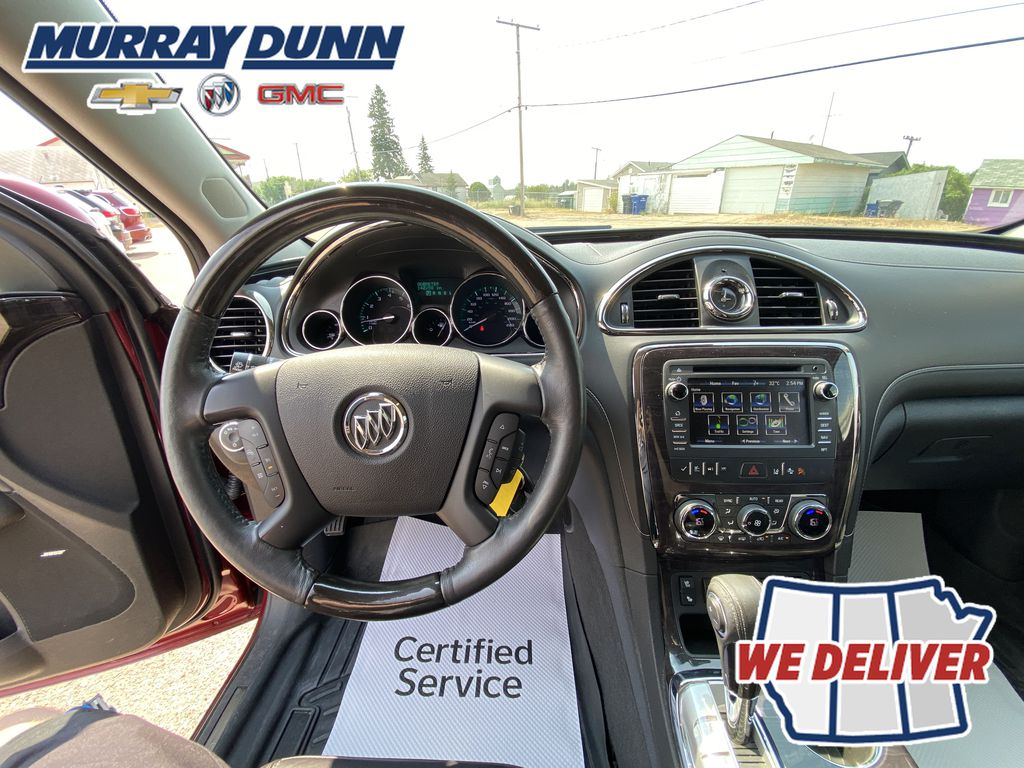 Red[Crimson Red Tintcoat] 2015 Buick Enclave Steering Wheel and Dash Photo in Nipawin SK