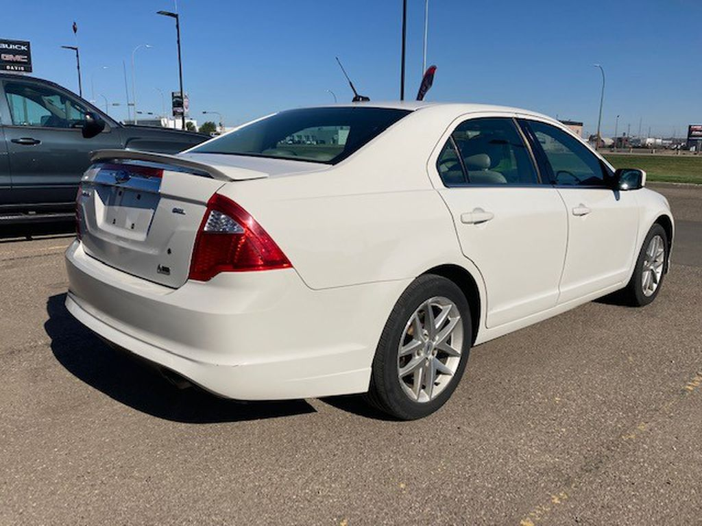 White 2010 Ford Fusion Left Front Rim and Tire Photo in Lethbridge AB