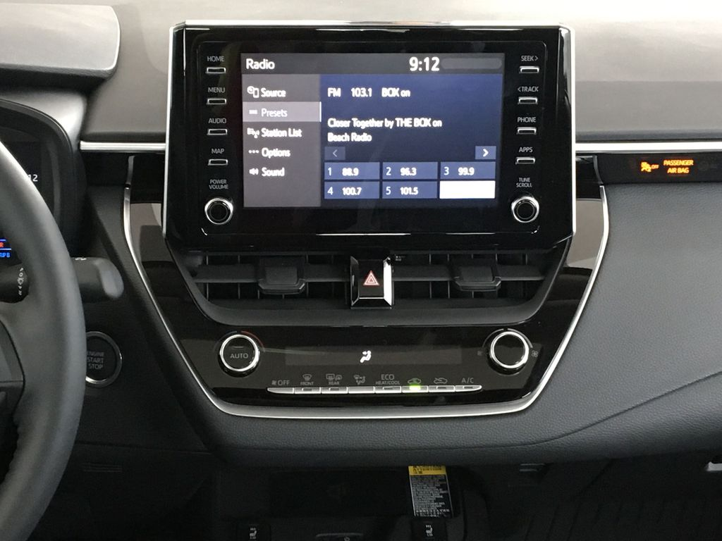 Red[Barcelona Red Metallic] 2021 Toyota Corolla Central Dash Options Photo in Kelowna BC