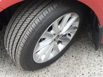Red[Barcelona Red Metallic] 2021 Toyota Corolla Left Front Rim and Tire Photo in Kelowna BC