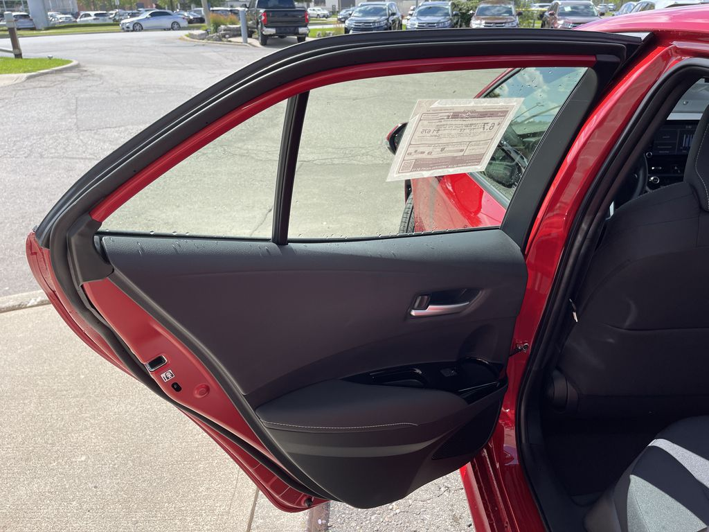 Red[Supersonic Red  w/Black Roof] 2021 Toyota Corolla Hatchback Standard Package K4RBEC AA Left Side Rear Seat  Photo in Brampton ON
