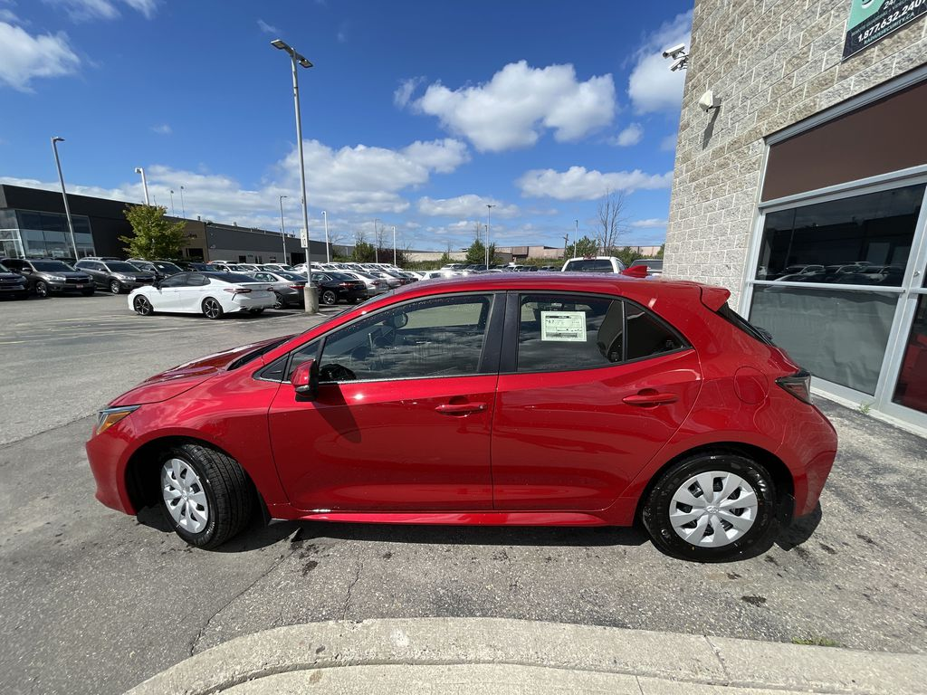 Red[Supersonic Red  w/Black Roof] 2021 Toyota Corolla Hatchback Standard Package K4RBEC AA Left Front Rim and Tire Photo in Brampton ON
