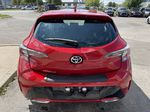 Red[Supersonic Red  w/Black Roof] 2021 Toyota Corolla Hatchback Standard Package K4RBEC AA Left Front Interior Photo in Brampton ON