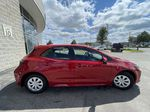 Red[Supersonic Red  w/Black Roof] 2021 Toyota Corolla Hatchback Standard Package K4RBEC AA Front Vehicle Photo in Brampton ON