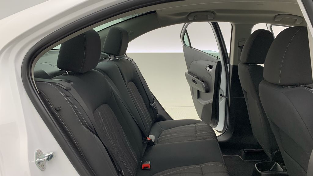 White[Summit White] 2018 Chevrolet Sonic LT Sedan - 6-Speed A/T, 4 Cylinder Engine, Front Wheel Drive Right Side Rear Seat  Photo in Winnipeg MB