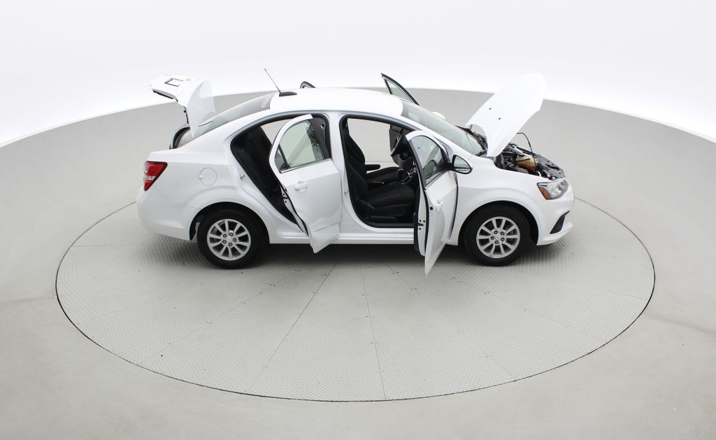 White[Summit White] 2018 Chevrolet Sonic LT Sedan - 6-Speed A/T, 4 Cylinder Engine, Front Wheel Drive Right Side Photo in Winnipeg MB