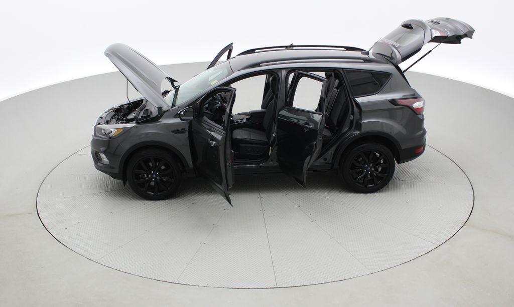 Gray[Magnetic] 2017 Ford Escape SE 4WD - Sport Package w/ Black Wheels / Grille Left Side Photo in Winnipeg MB