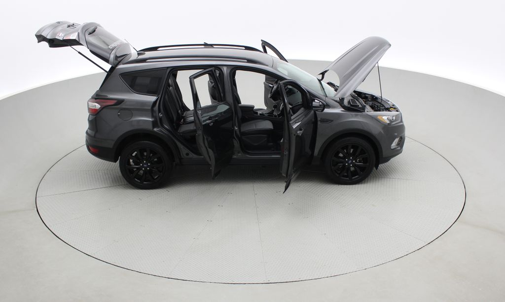 Gray[Magnetic] 2017 Ford Escape SE 4WD - Sport Package w/ Black Wheels / Grille Right Side Photo in Winnipeg MB