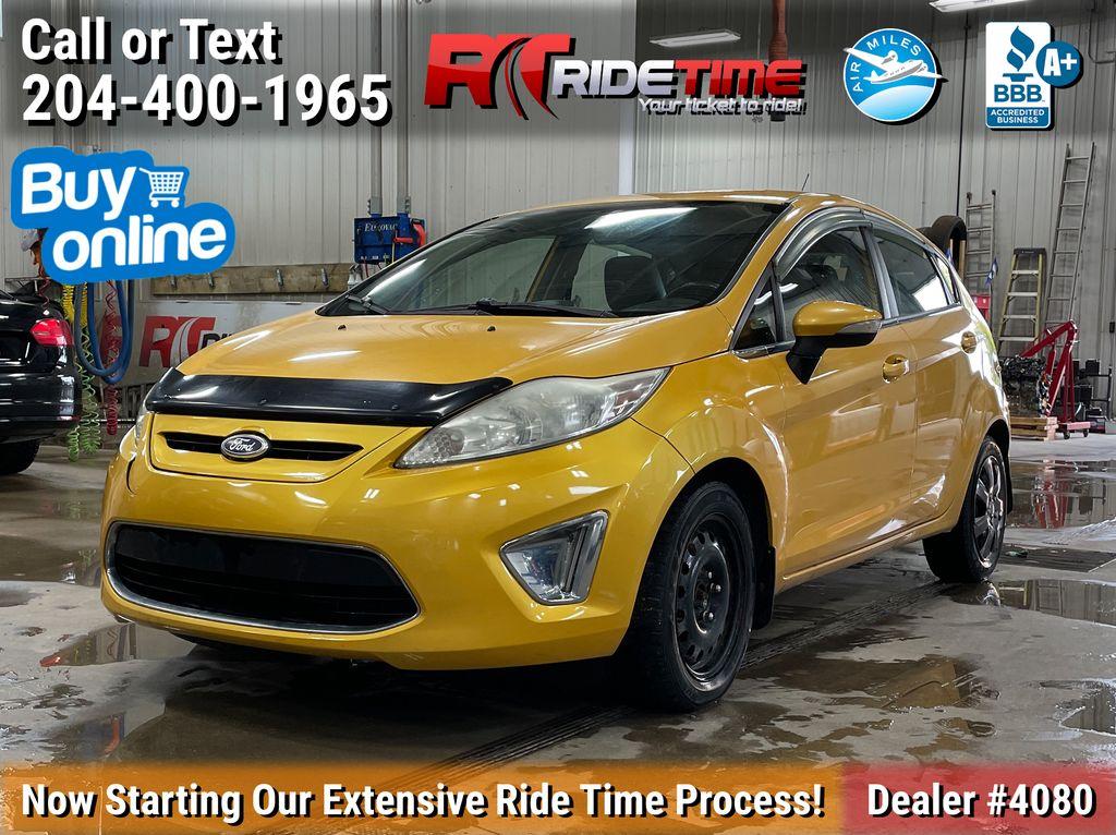 Yellow[Yellow Blaze Metallic Tri-Coat] 2011 Ford Fiesta
