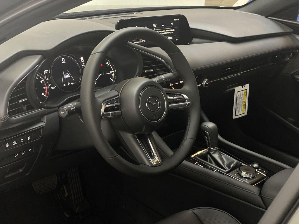 TITANIUM FLASH MICA(42S) 2021 Mazda Mazda3 Sport GT Premium FWD Steering Wheel and Dash Photo in Edmonton AB