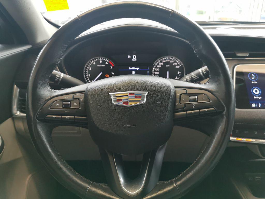 Black[Stellar Black Metallic] 2019 Cadillac XT4 Steering Wheel and Dash Photo in Edmonton AB