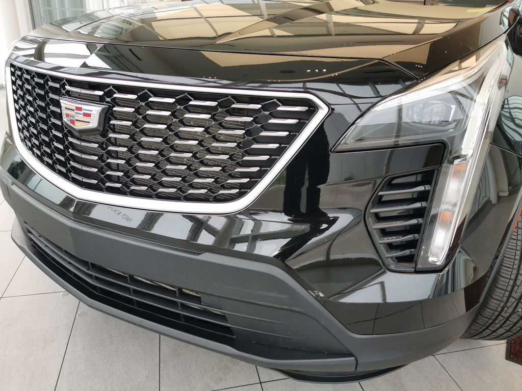 Black[Stellar Black Metallic] 2019 Cadillac XT4 Left Front Head Light / Bumper and Grill in Edmonton AB
