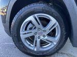 Black[Ebony Twilight Metallic] 2020 GMC Terrain SLE Left Front Rim and Tire Photo in Calgary AB