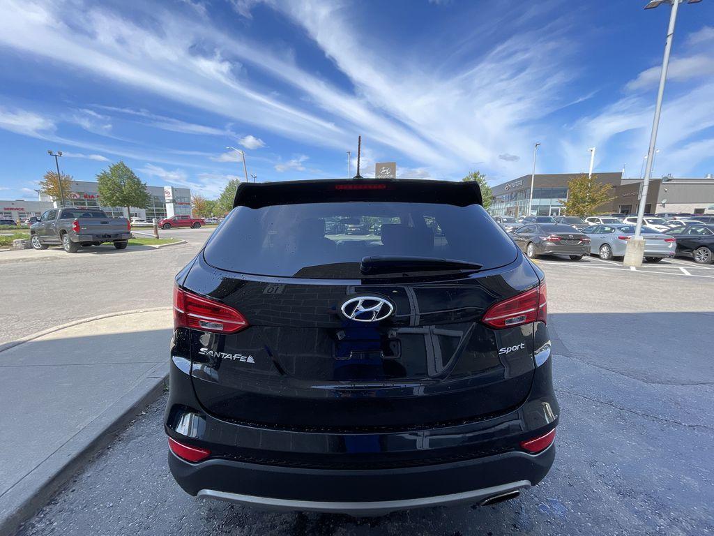 Silver[Moonstone Silver] 2015 Hyundai Santa Fe cleaned Left Front Interior Photo in Brampton ON