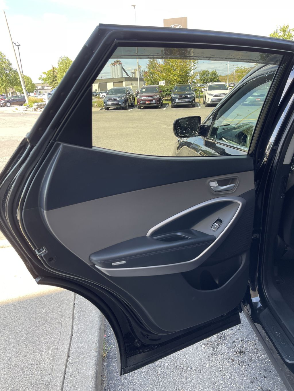 Silver[Moonstone Silver] 2015 Hyundai Santa Fe cleaned Left Side Rear Seat  Photo in Brampton ON