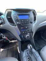 Silver[Moonstone Silver] 2015 Hyundai Santa Fe cleaned Strng Wheel/Dash Photo: Frm Rear in Brampton ON