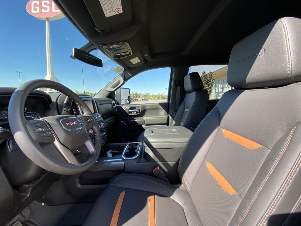 White[Summit White] 2022 GMC Sierra 2500HD AT4 Left Front Interior Photo in Calgary AB