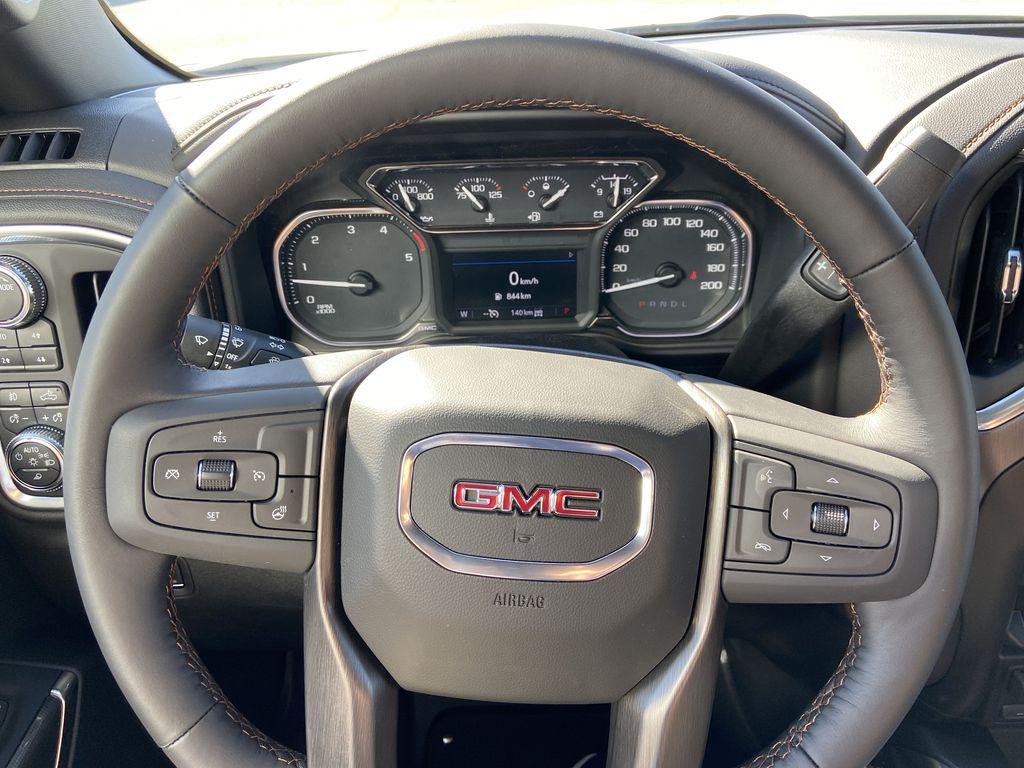 White[Summit White] 2022 GMC Sierra 2500HD AT4 Steering Wheel and Dash Photo in Calgary AB