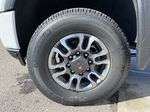 White[Summit White] 2022 GMC Sierra 2500HD AT4 Left Front Rim and Tire Photo in Calgary AB