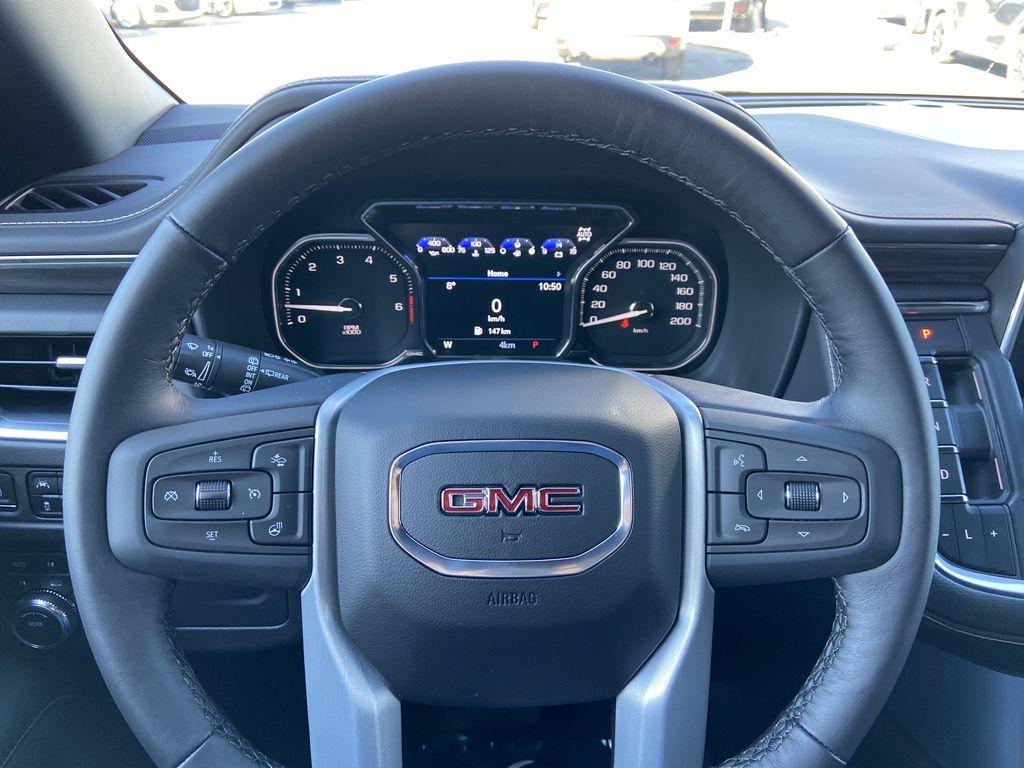 White[Summit White] 2021 GMC Yukon SLT Steering Wheel and Dash Photo in Calgary AB