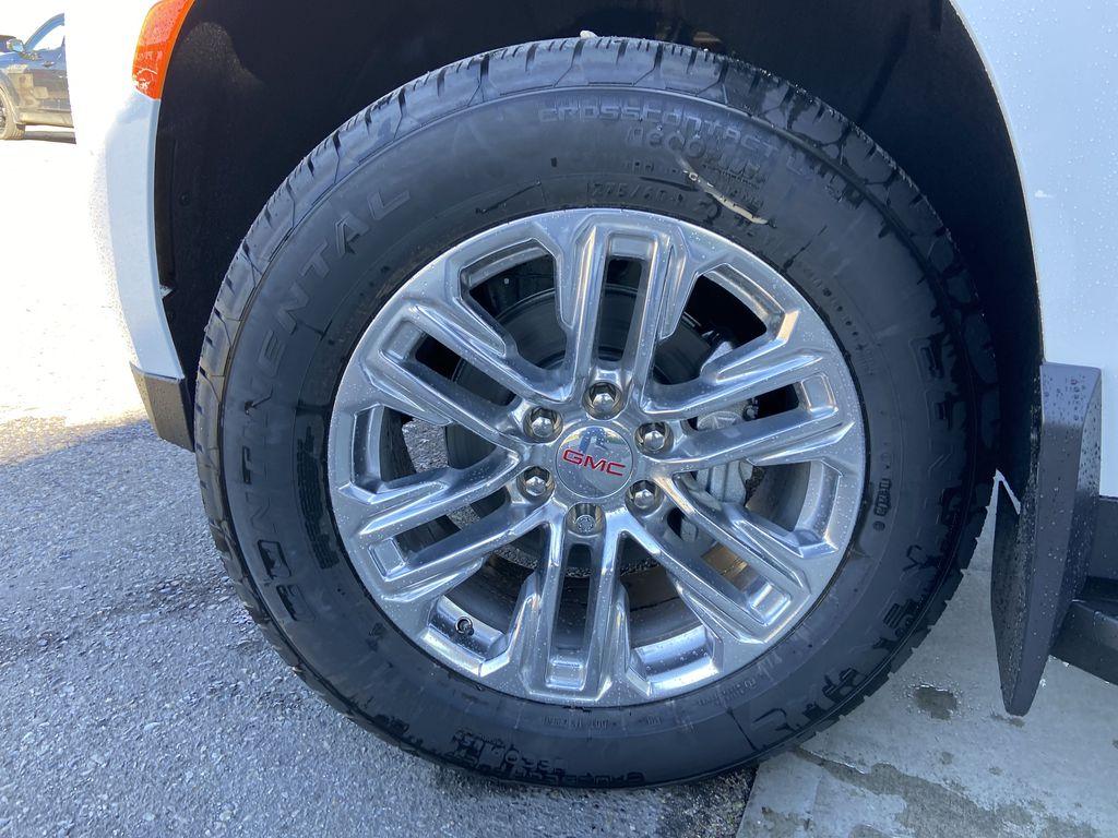 White[Summit White] 2021 GMC Yukon SLT Left Front Rim and Tire Photo in Calgary AB