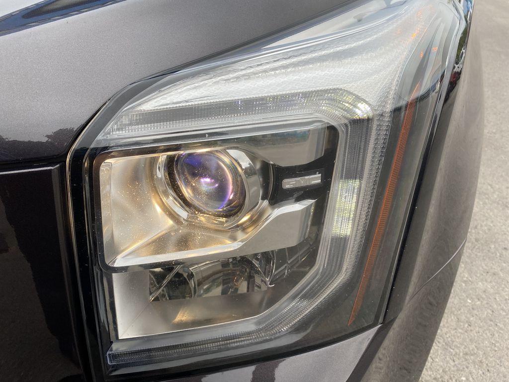 Gray[Iridium Metallic] 2017 GMC Yukon SLT Left Front Head Light / Bumper and Grill in Canmore AB