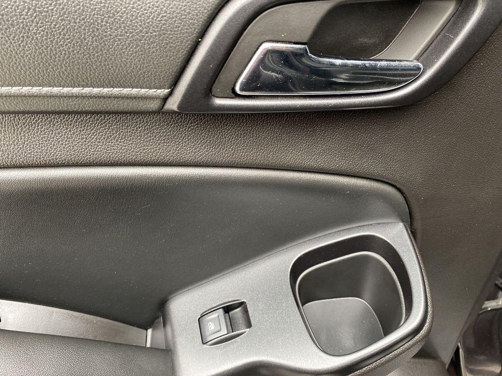 Gray[Iridium Metallic] 2017 GMC Yukon SLT LR Door Panel Ctls Photo in Canmore AB