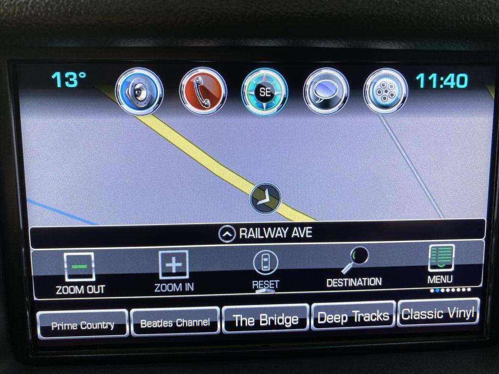 Gray[Iridium Metallic] 2017 GMC Yukon SLT Navigation Screen Closeup Photo in Canmore AB