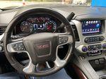 Gray[Iridium Metallic] 2017 GMC Yukon SLT Steering Wheel and Dash Photo in Canmore AB