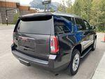 Gray[Iridium Metallic] 2017 GMC Yukon SLT Right Rear Corner Photo in Canmore AB