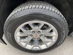 Gray[Iridium Metallic] 2017 GMC Yukon SLT Left Front Rim and Tire Photo in Canmore AB