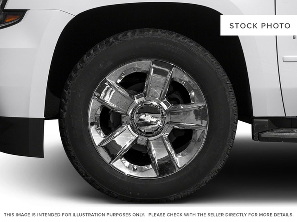 White[Iridescent Pearl Tricoat] 2017 Chevrolet Tahoe Left Front Rim and Tire Photo in Fort Macleod AB