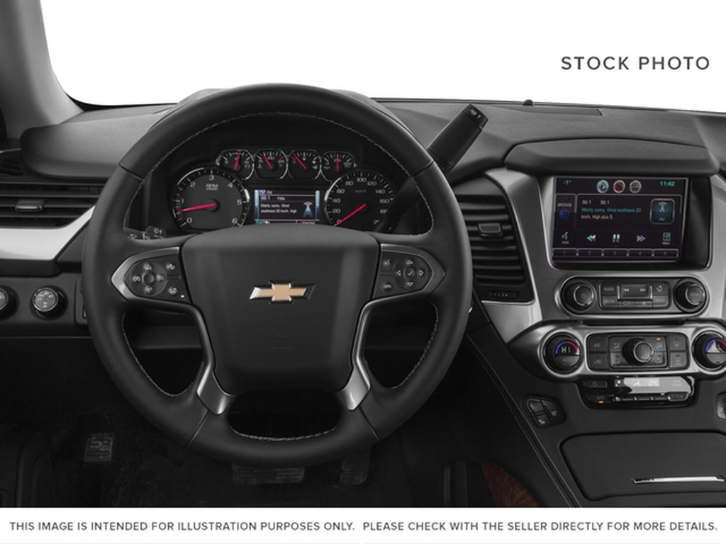 White[Iridescent Pearl Tricoat] 2017 Chevrolet Tahoe Steering Wheel and Dash Photo in Fort Macleod AB