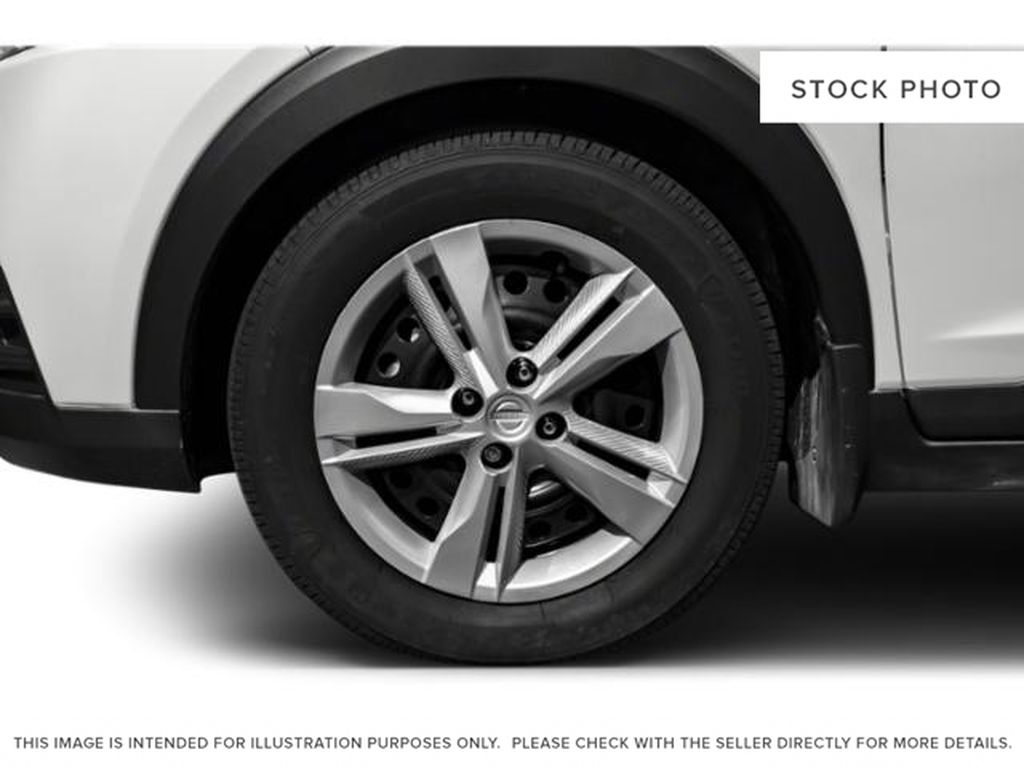 Blue[Deep Blue Pearl] 2018 Nissan Kicks Left Front Rim and Tire Photo in Lethbridge AB