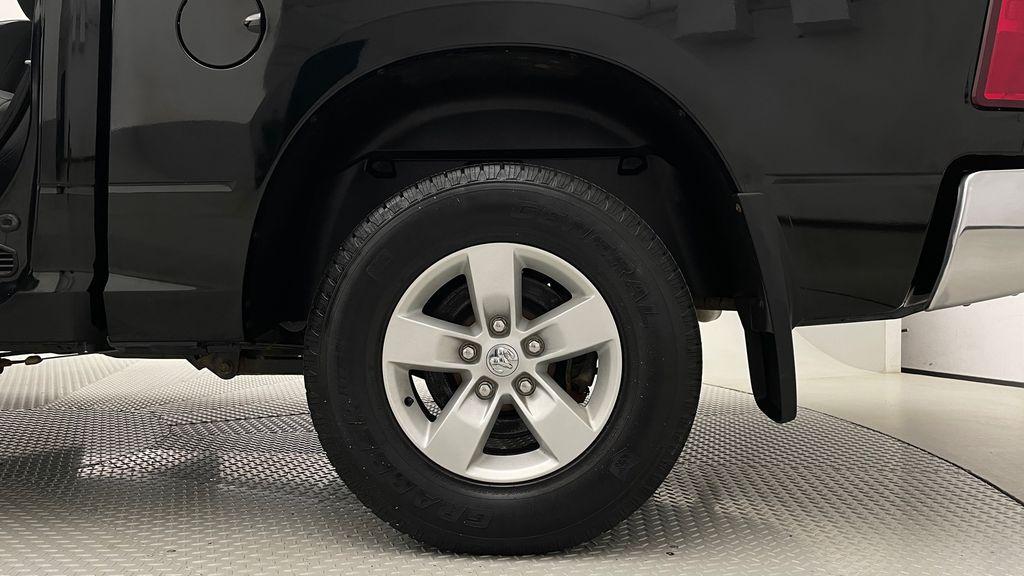 Green[Black Forest Green Pearl] 2016 Ram 1500 SXT 4WD - Crew Cab, 8 Speed Transmission, 3.6L V6 Left Rear Rim and Tire Photo in Winnipeg MB