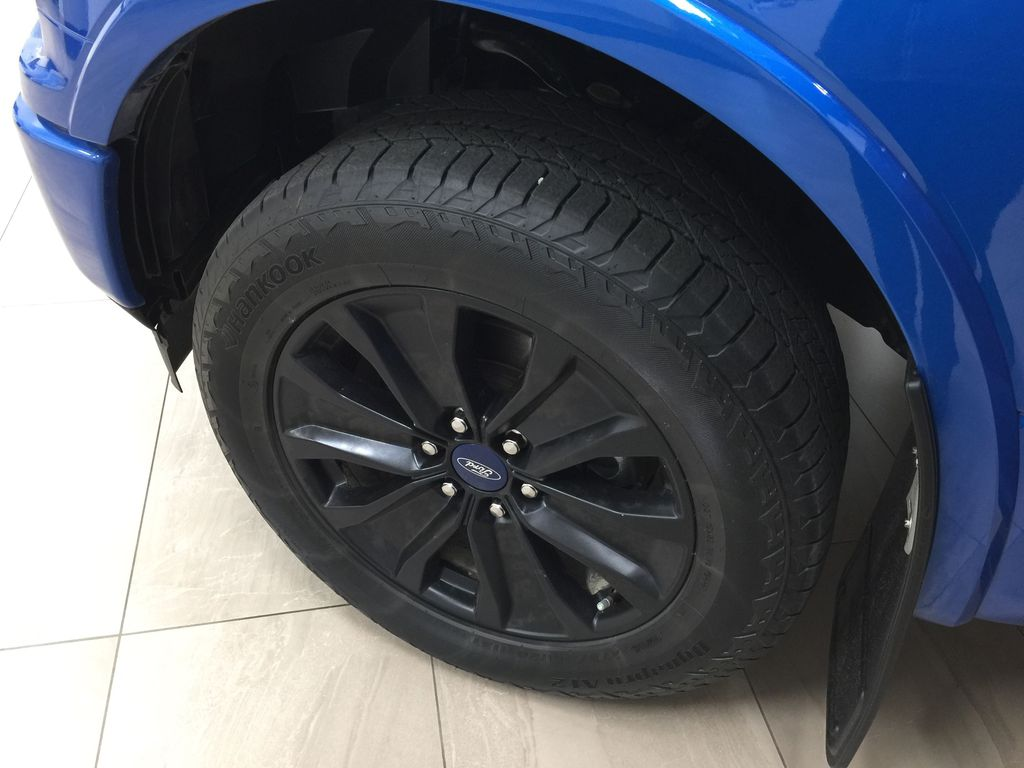 BLUE 2019 Ford F-150 XLT SPORT CREWCAB 5.0L V8 Left Front Rim and Tire Photo in Sherwood Park AB