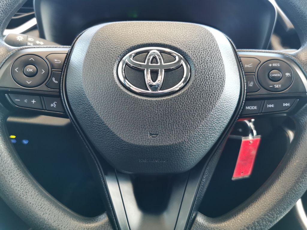 Black[Midnight Black Metallic] 2021 Toyota RAV4 Steering Wheel and Dash Photo in Edmonton AB