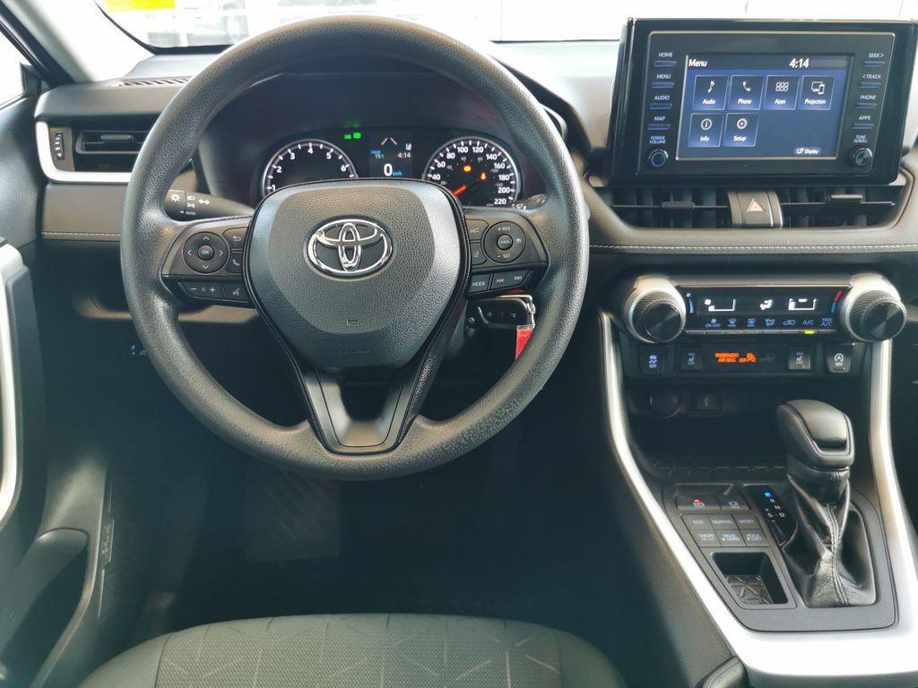 Black[Midnight Black Metallic] 2021 Toyota RAV4 Strng Wheel/Dash Photo: Frm Rear in Edmonton AB