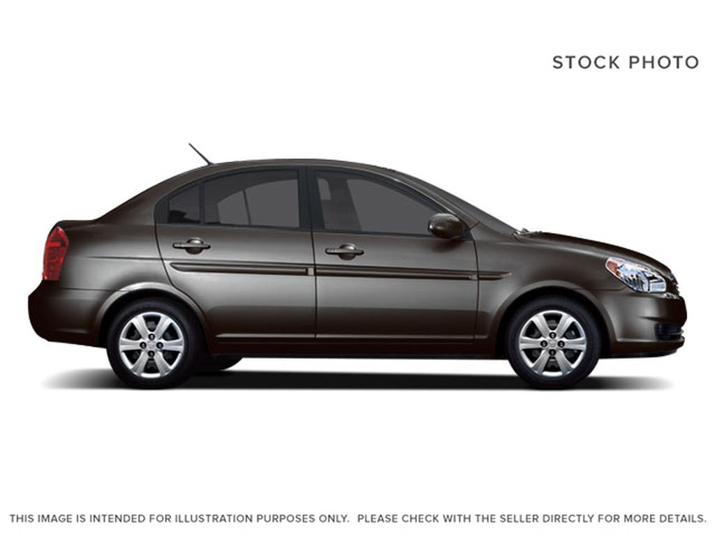 Gray[Midnight Grey Pearl] 2009 Hyundai Accent Left Side Photo in Ottawa ON