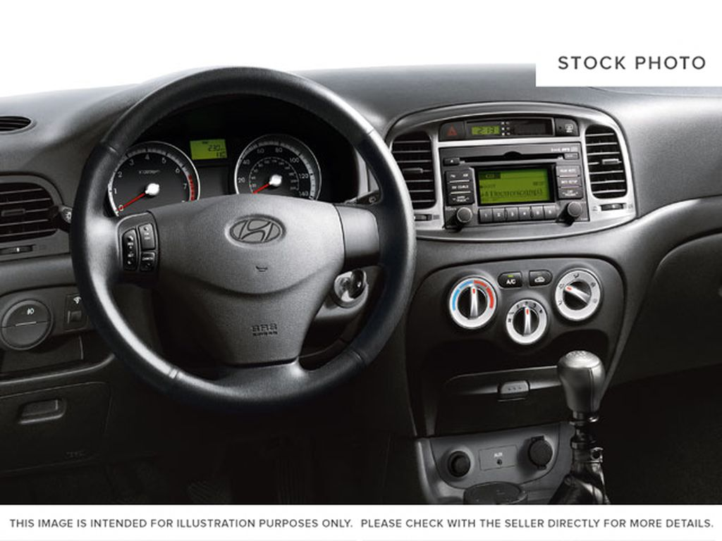 Gray[Midnight Grey Pearl] 2009 Hyundai Accent Steering Wheel and Dash Photo in Ottawa ON
